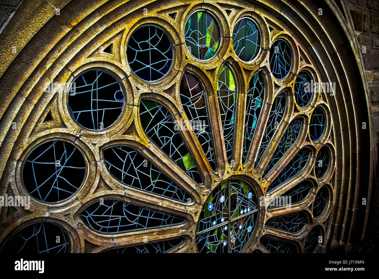 Stained glass windows of the Sagrada Familia Cathedral in Barcelona, Spain - Stock Image
