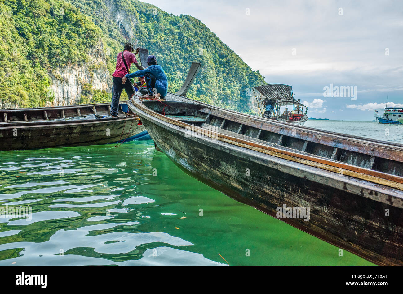 Boats and boaters in Phuket. Thailand. - Stock Image