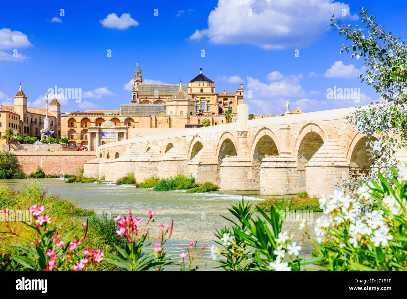Cordoba, Spain. The Roman Bridge and Mosque (Cathedral) on the Guadalquivir River. - Stock Image