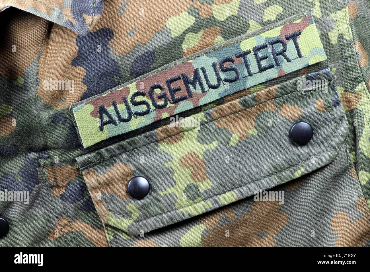 German camouflage uniform jacket patched WITHDRAWN FROM SERVICE instead of name tag - Stock Image