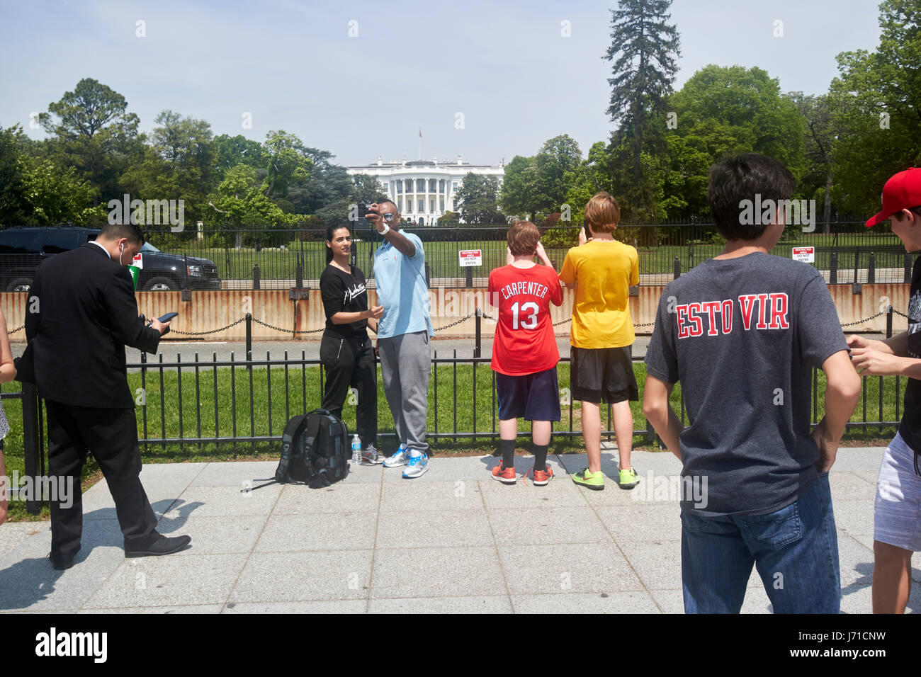 tourists take selfies outside security barriers on the south lawn of the white house Washington DC USA - Stock Image