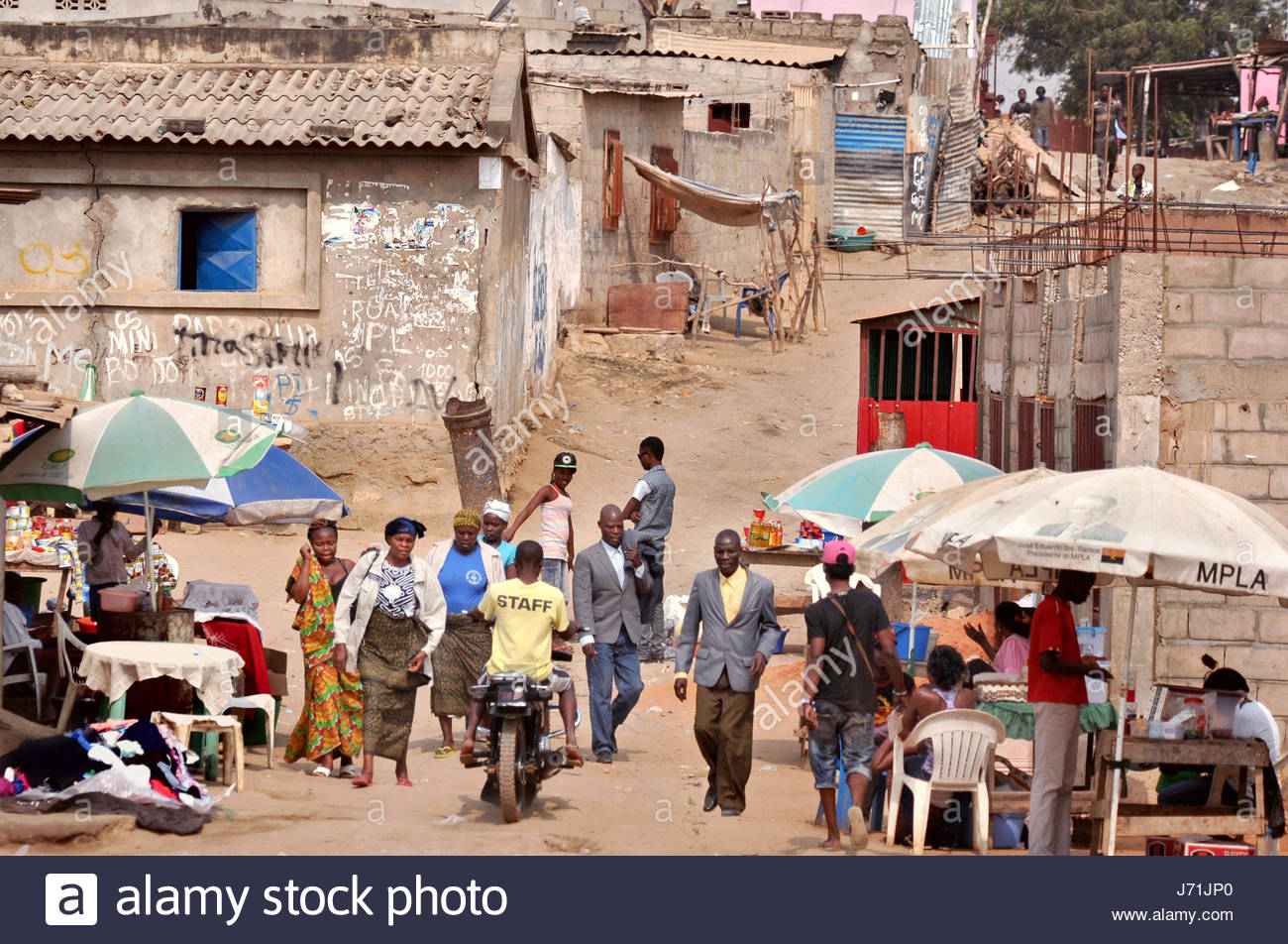 Luanda, Angola. 5th July, 2013. This typical street scene lies just outside the Capital city Luanda. This year marks - Stock Image