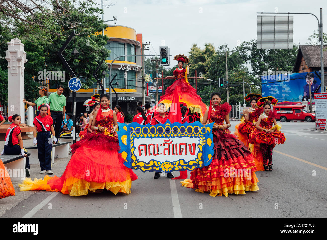 Chiang Mai, Thailand - August 24, 2016: Young girls and boys in festival costumes parade near the Three Kings Monument - Stock Image
