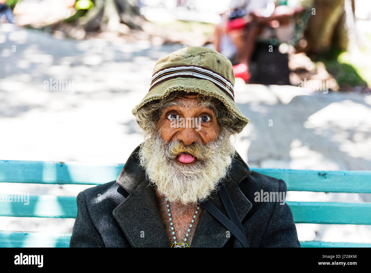 Cuban man, Cuban tramp, cuban vagrant, poverty in cuba, funny old man, cuban man, funny man, man sticking out tongue, - Stock Image