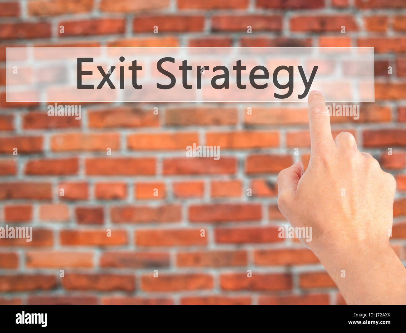 Exit Strategy - Hand pressing a button on blurred background concept . Business, technology, internet concept. Stock Stock Photo