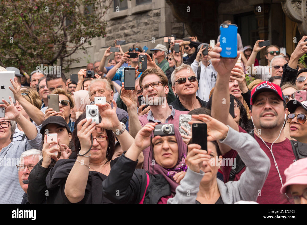 Montreal, CA - 21 May 2017: Spectators taking pictures with cell phones during Royal de Luxe show - Stock Image