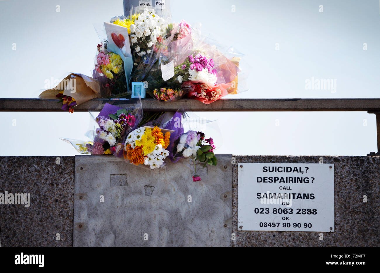 Floral tributes laid in memory of a suicide victim on Itchen bridge in Southampton, UK, with the Samaritans helpline Stock Photo