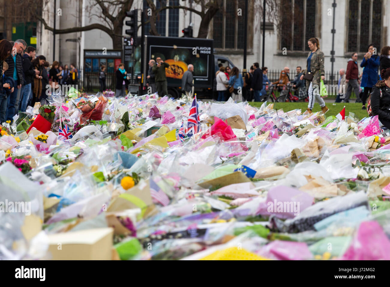 London, UK - 1st April, 2017: Parliament Square has been covered with flowers for those killed in terrorist attack, - Stock Image