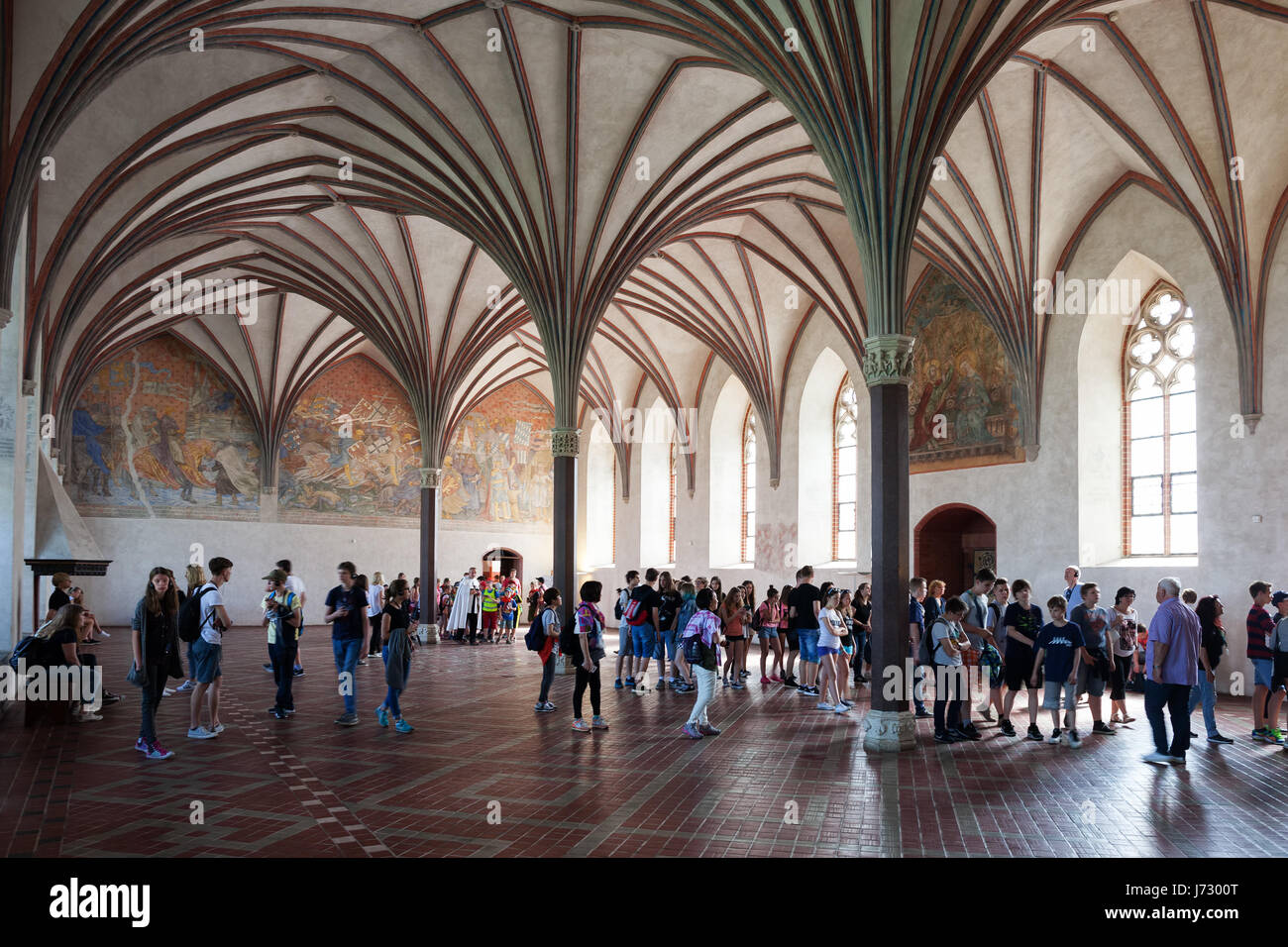 Poland Malbork Castle Interior The Grand Refectory With Gothic Rib Fan Vault In Middle Group Of School Children On Sightseeing Tour