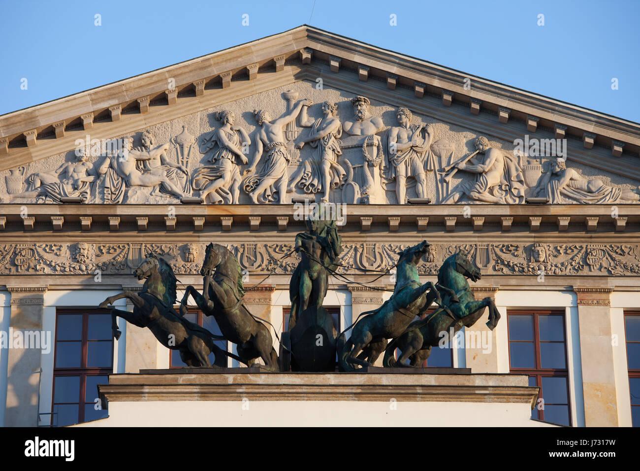 Grand Theatre and National Opera in Warsaw, Poland, pediment with relief, quadriga - Apollo driving a chariot drawn - Stock Image