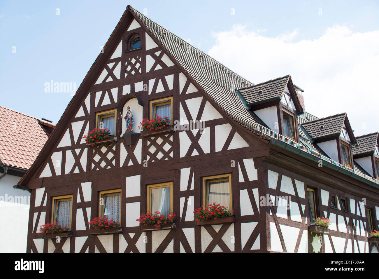 Cute bavarian tudor style houses germany stock photo for Traditionelles deutsches haus