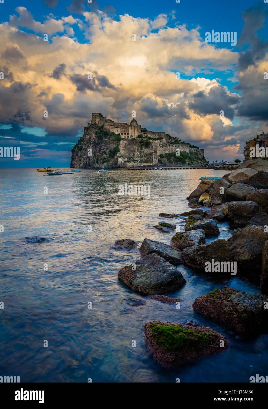 Castello Aragonese is a medieval castle next to Ischia (one of the Phlegraean Islands), at the northern end of the - Stock Image