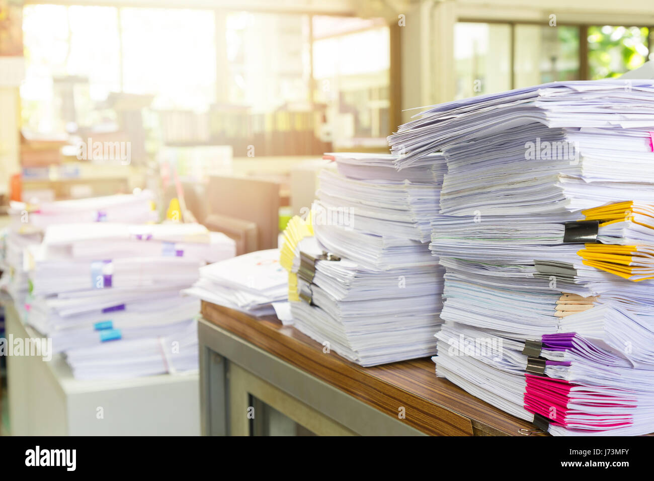 Pile of unfinished documents on office desk, Stack of business paper - Stock Image
