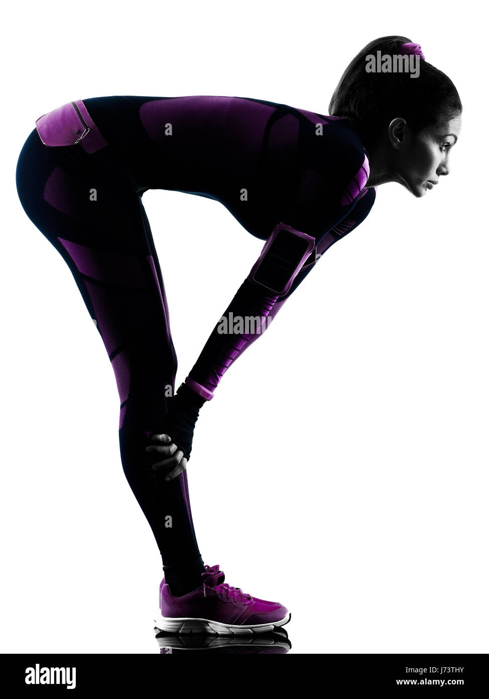 one young caucasian woman runner running jogger jogging isolated silhouette shadow on white background - Stock Image