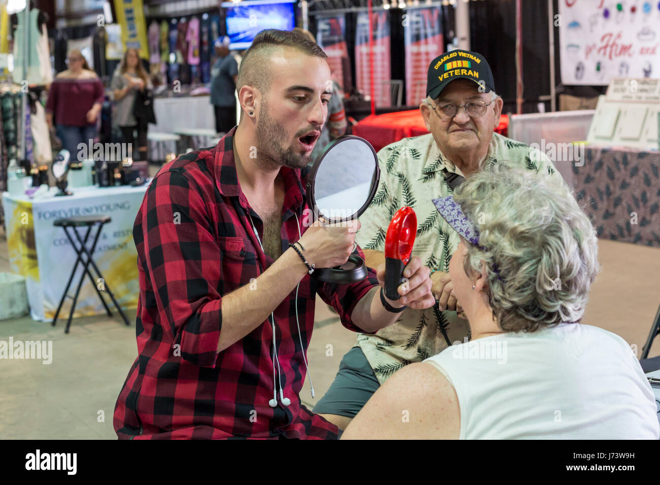 Phoenix, Arizona - A salesman discusses the Forever Young collagen and restylane treatment to a woman at the Maricopa - Stock Image