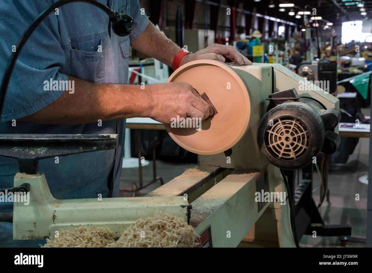 Phoenix, Arizona - A craftsman demonstrates producing a wooden bowl at the Maricopa County Fair. - Stock Image