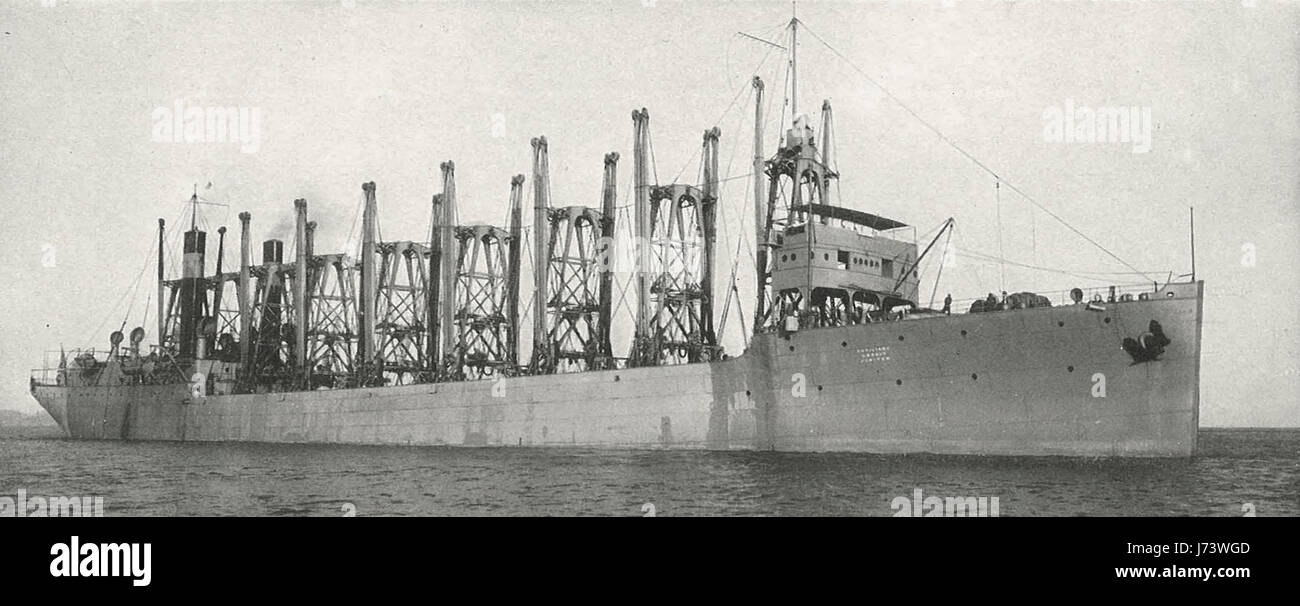 The Collier Jupiter, circa 1915. The Jupiter has thirteen cargo holds and her coal capacity is 12,500 tons - Stock Image