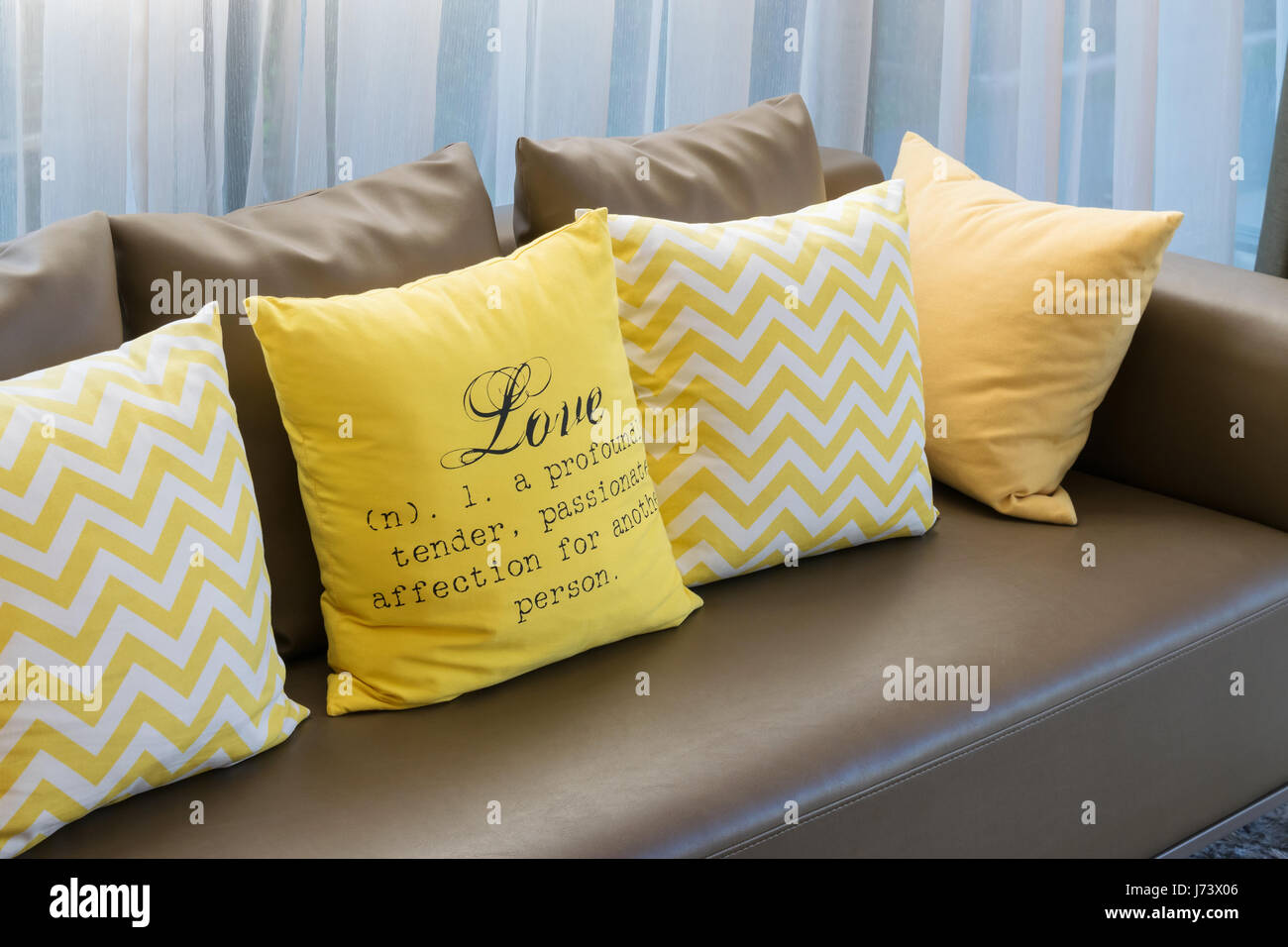 Modern Living Room Design With Brown Sofa And Yellow Pillows Stock Photo Alamy
