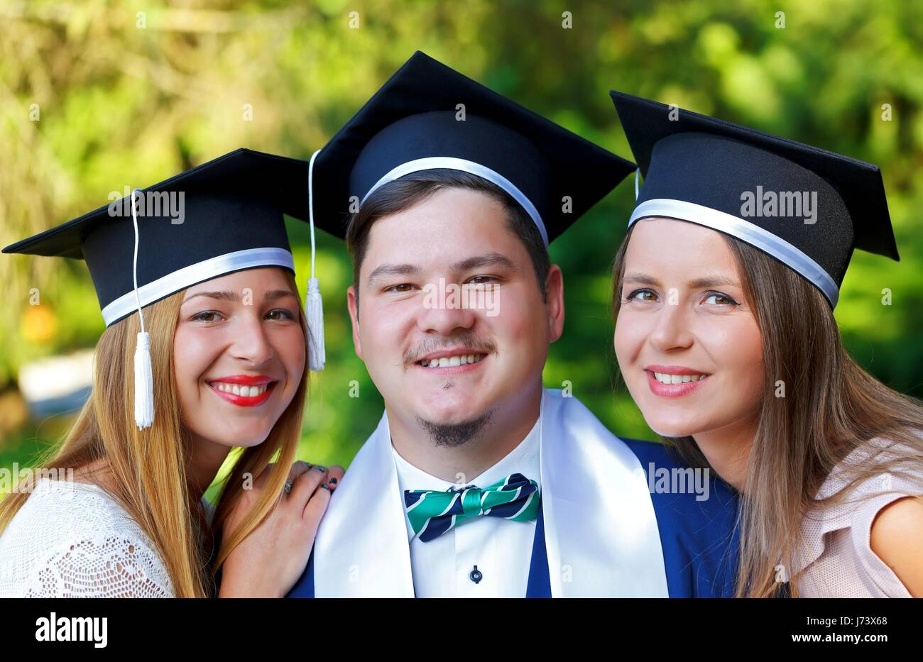 Group of happy students enjoy their graduation day - Stock Image
