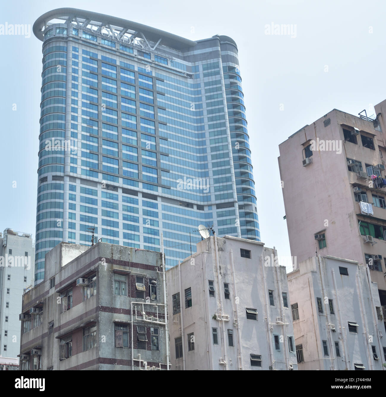 Revamp of decrepit area in Kowloon  where residential block gradually gives way to commercial building. - Stock Image