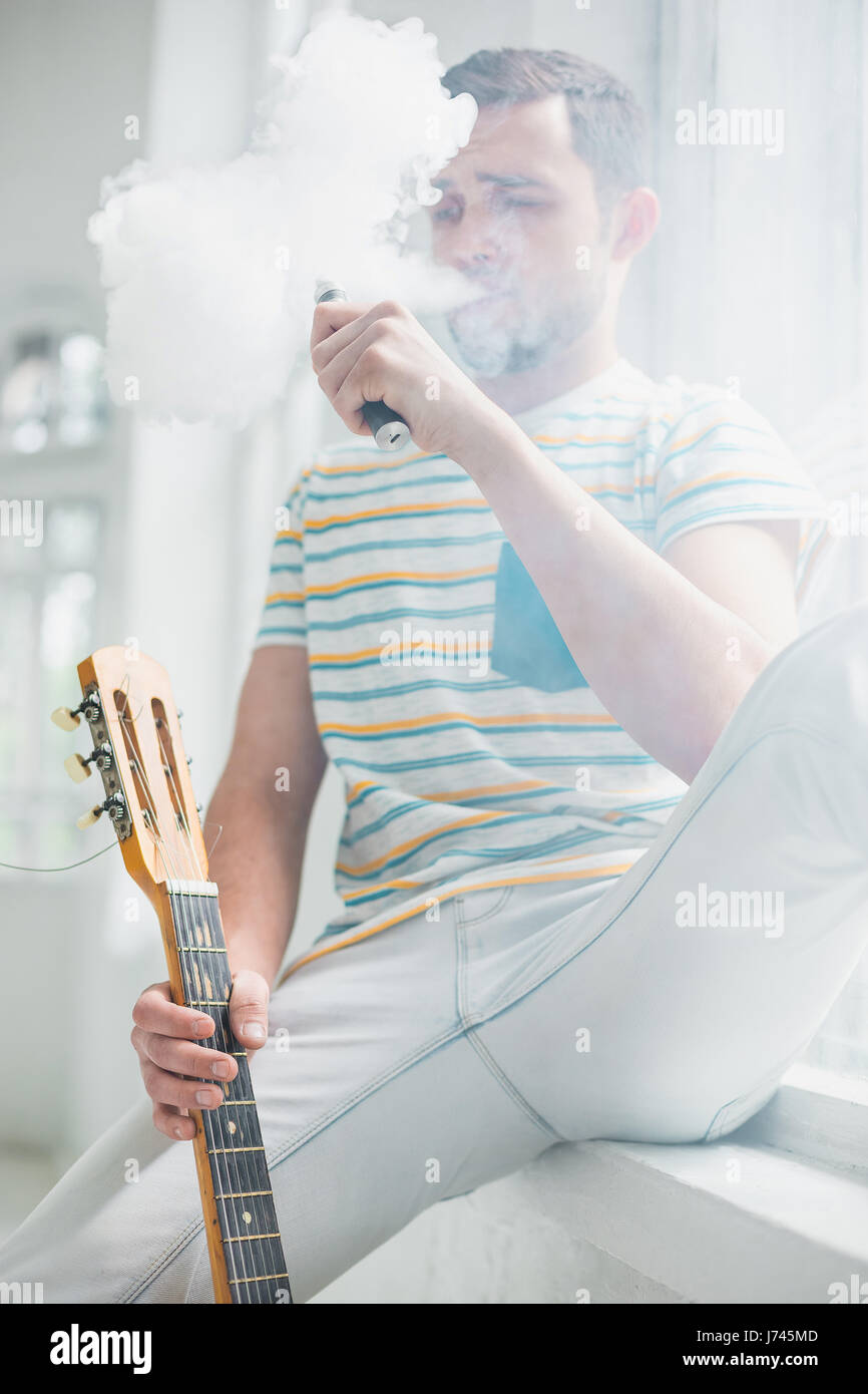 The face of vaping young man - Stock Image