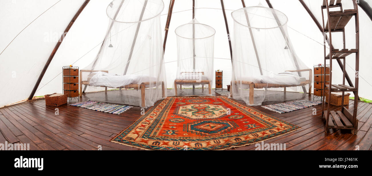 Large tipi with three beds , glamping. - Stock Image