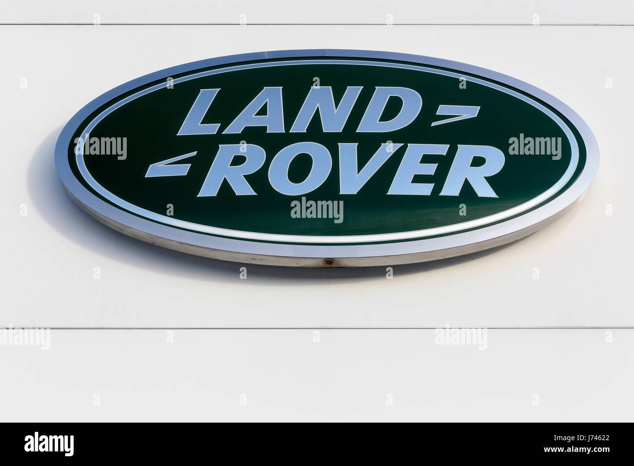 Aarhus, Denmark - January 17, 2016:Land Rover logo on a wall. Land Rover is a car brand that specialises in four - Stock Image