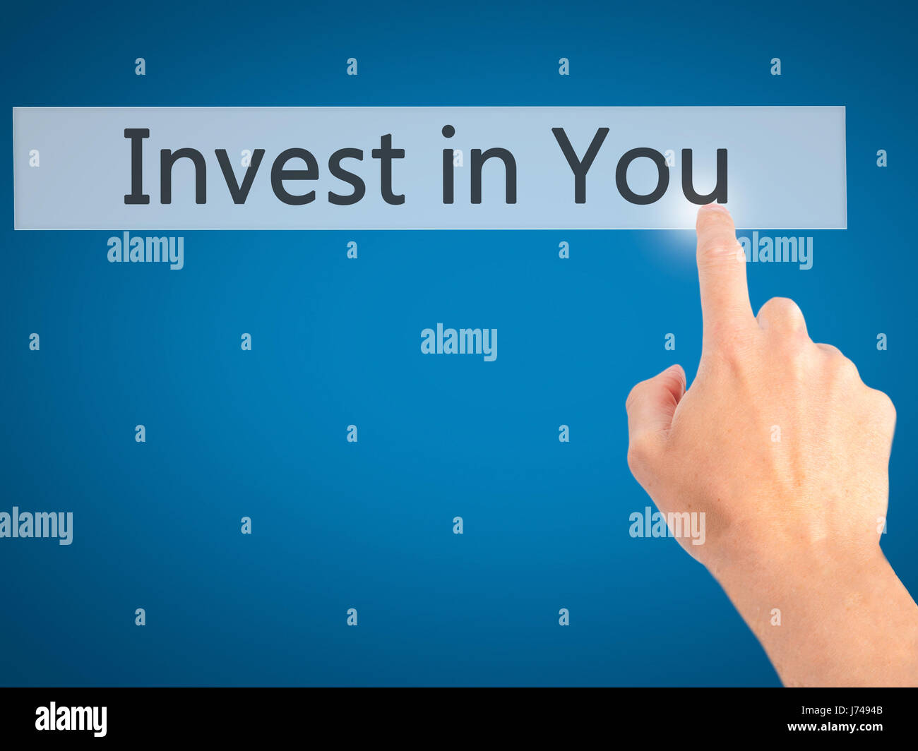 Invest in You - Hand pressing a button on blurred background concept . Business, technology, internet concept. Stock Stock Photo