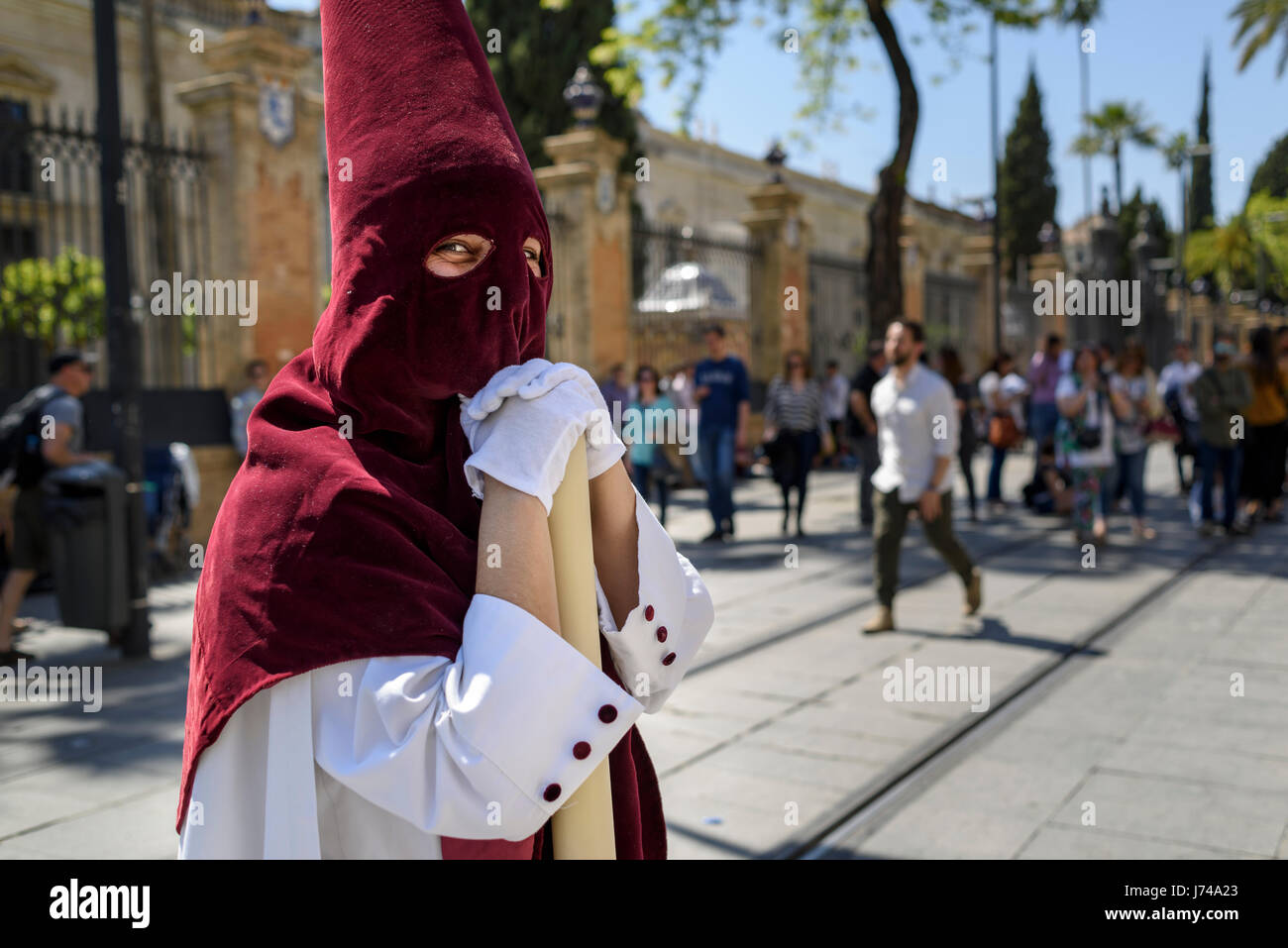Portrait Of A Nazarene Penitent With Red Hood And White Robes Stock Photo Alamy