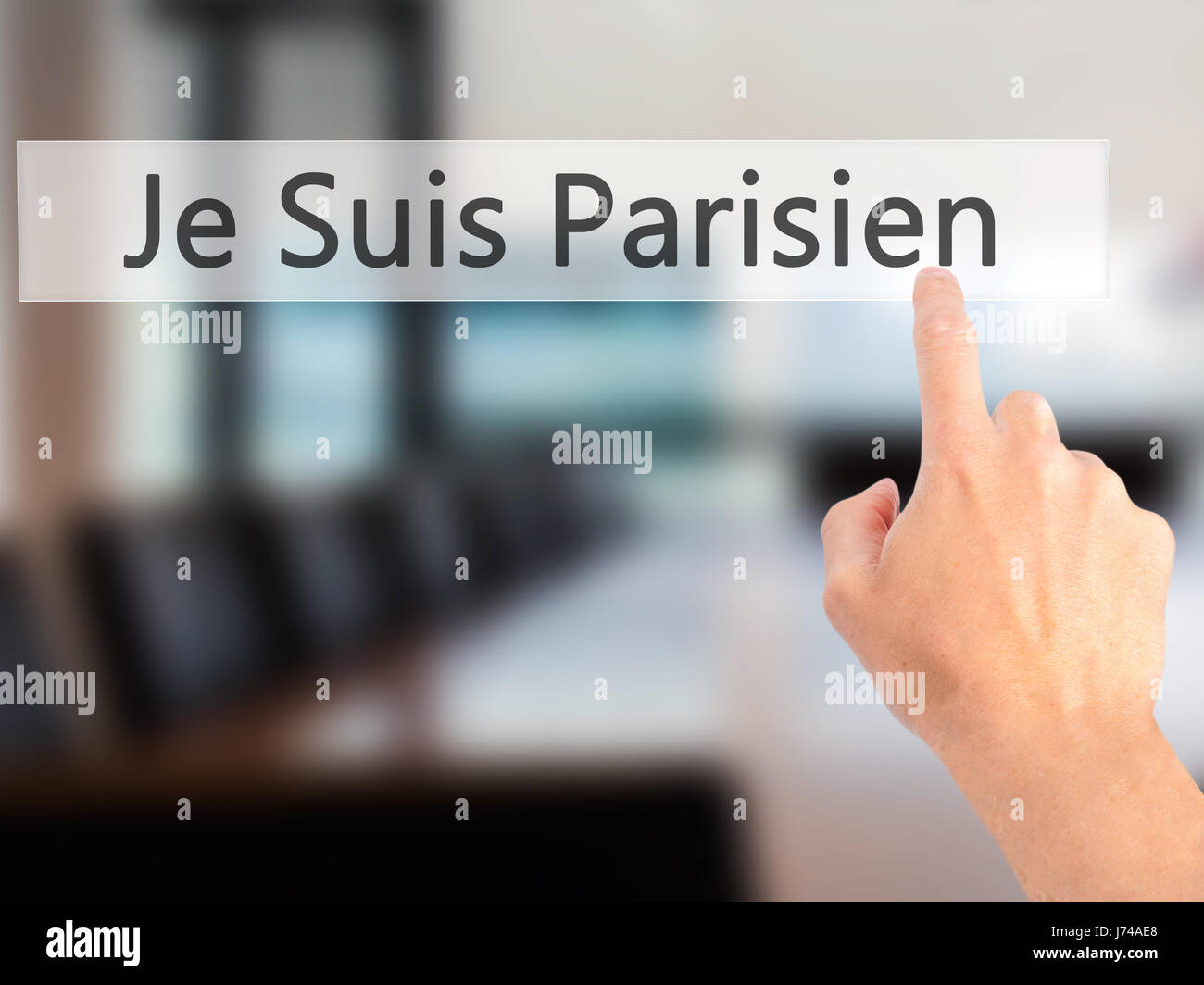 Je Suis Parisien ( I am Parisien)  - Hand pressing a button on blurred background concept . Business, technology, Stock Photo