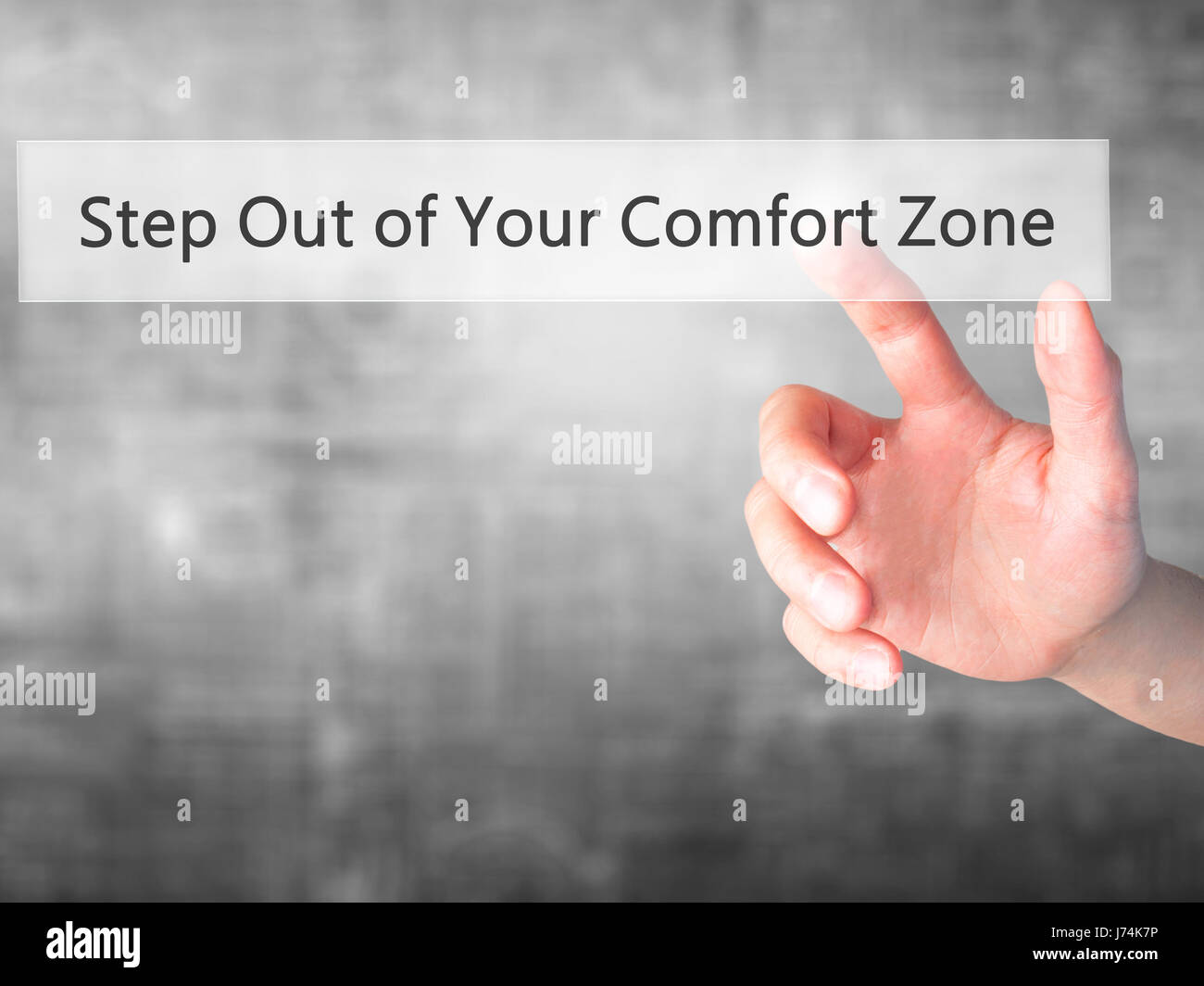 Step Out of Your Comfort Zone - Hand pressing a button on blurred background concept . Business, technology, internet concept. Stock Photo Stock Photo