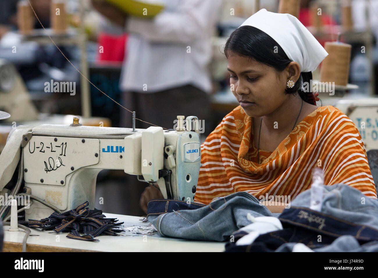 Garments workers work at factory. Dhaka, Bangladesh. - Stock Image