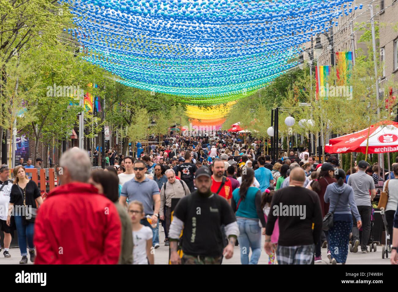 Montreal, CA - 21 May 2017: Rainbow balls art installation '18 shades of gay' on Saint-Catherine Street - Stock Image