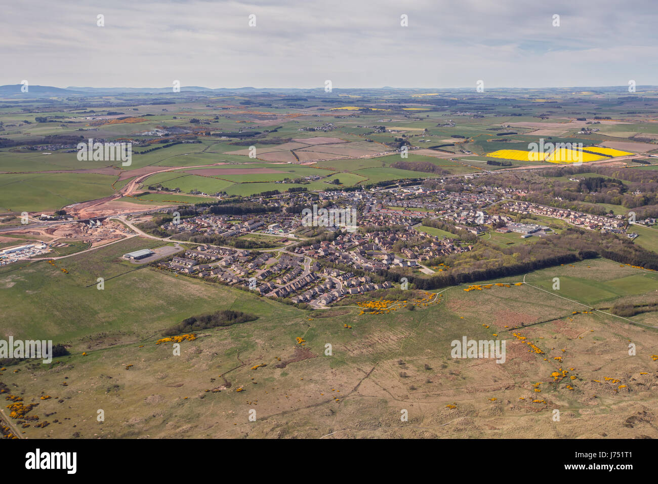 Aerial photograph of the town of Balmedie near the city of Aberdeen in North east Scotland, UK - Stock Image