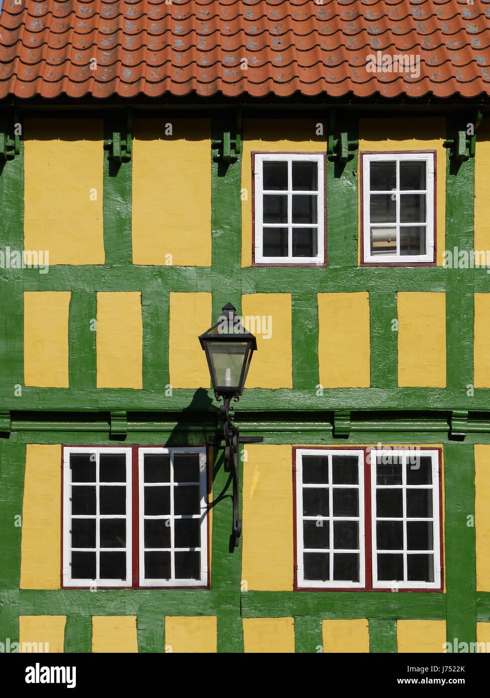 facade lantern old building restores house building historical green frame-work Stock Photo