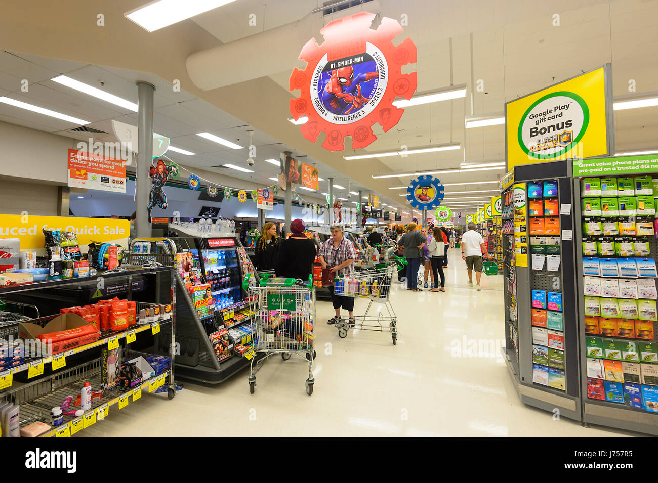 Customers queueing up at Check-outs at Woolworths, Kiama, New South Wales, NSW, Australia - Stock Image