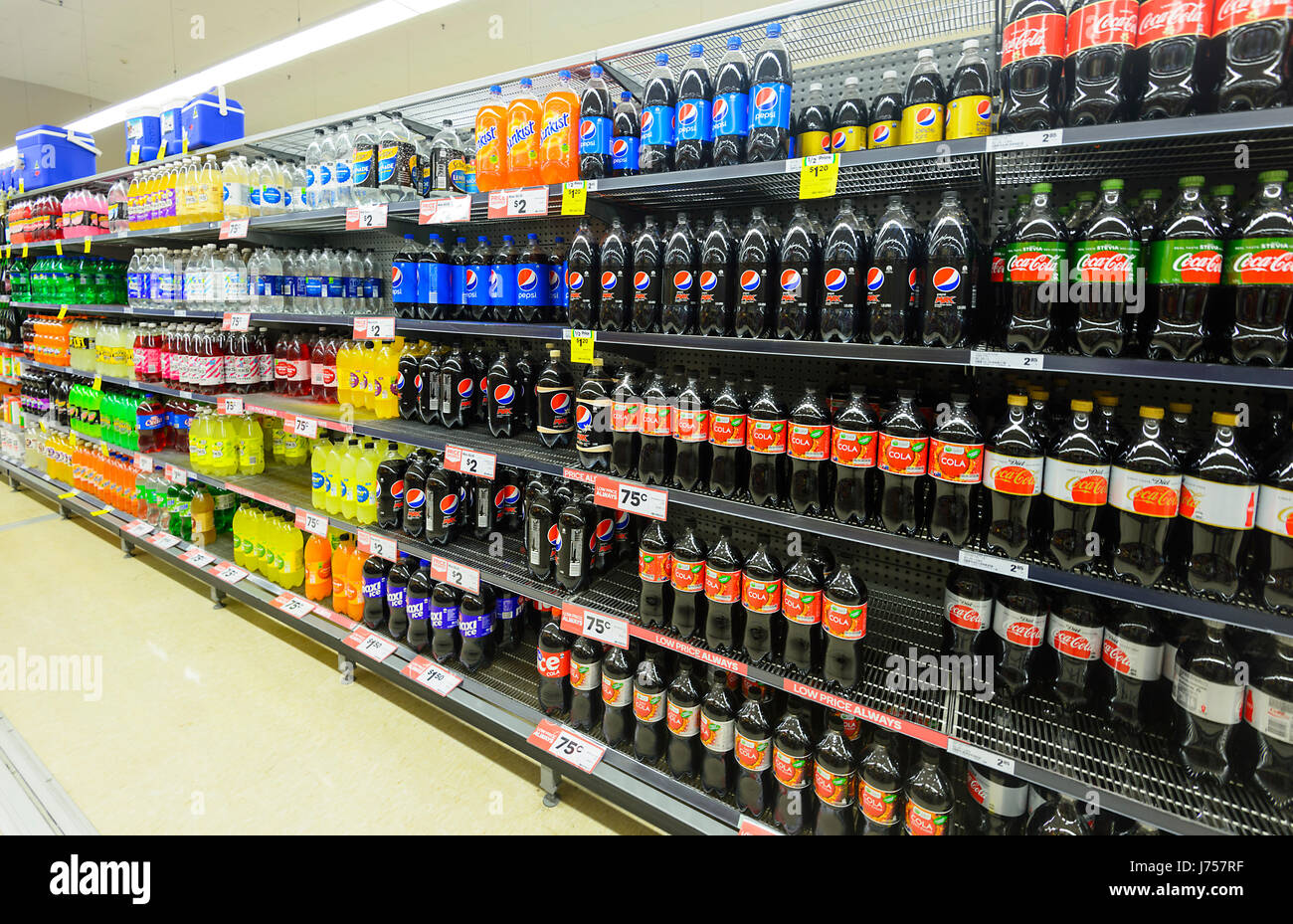 Shelves stacked up with Soft Drinks at Woolworths, Kiama, New South Wales, NSW, Australia - Stock Image