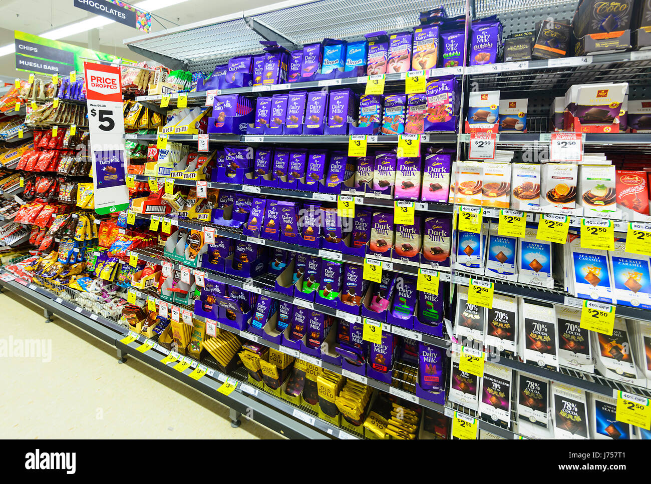 Shelves stacked up with Chocolates at Woolworths, Kiama, New South Wales, NSW, Australia - Stock Image