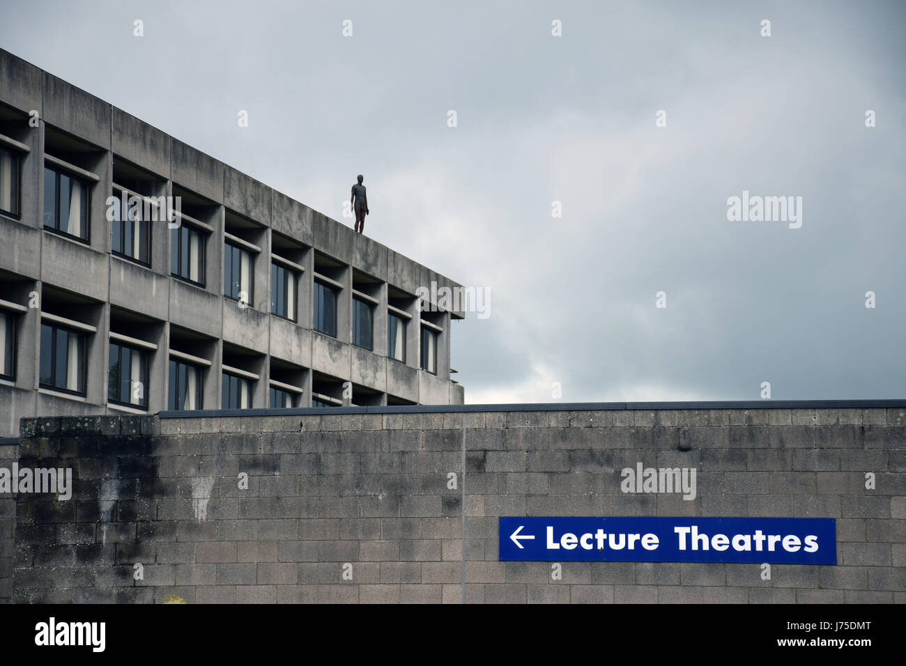 Newly installed Antony Gormley statue on top of the University of East Anglia library. May 2017 UK - Stock Image