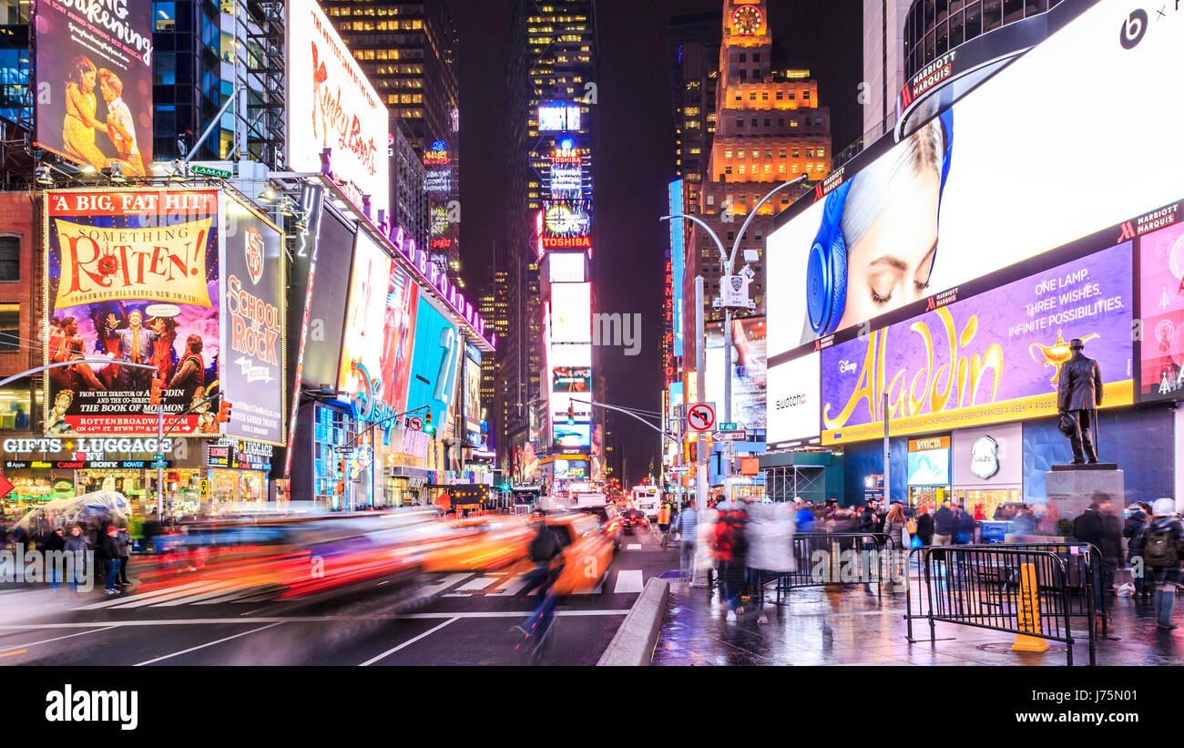 Times Square in New York city at night. - Stock Image