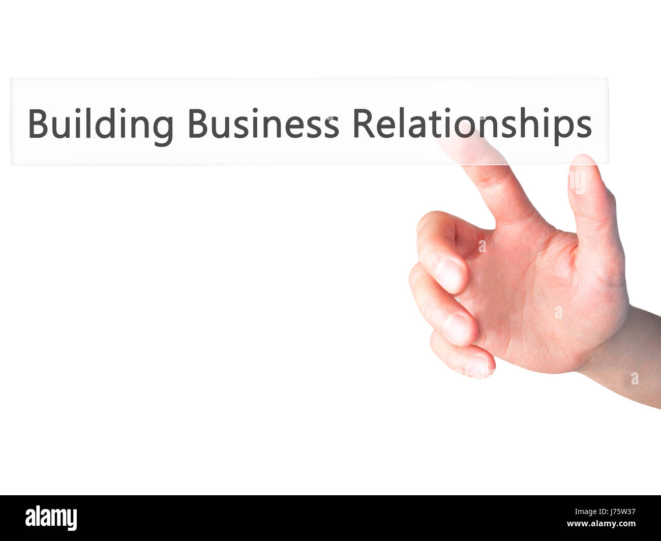 Building Business Relationships - Hand pressing a button on blurred background concept . Business, technology, internet - Stock Image