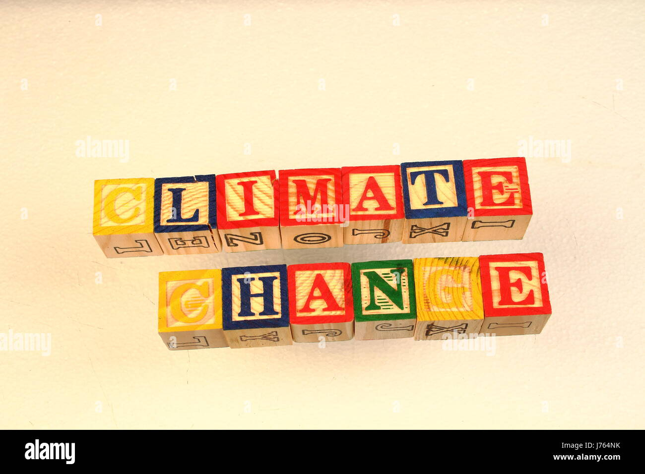 The term climate change visually displayed using colorful wooden toy blocks Stock Photo