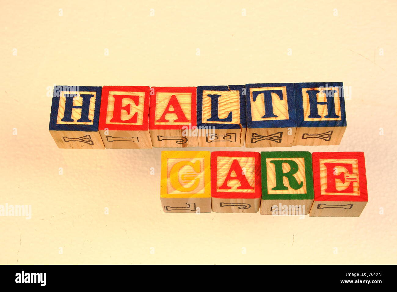 The term health care visually displayed using colorful wooden toy blocks Stock Photo
