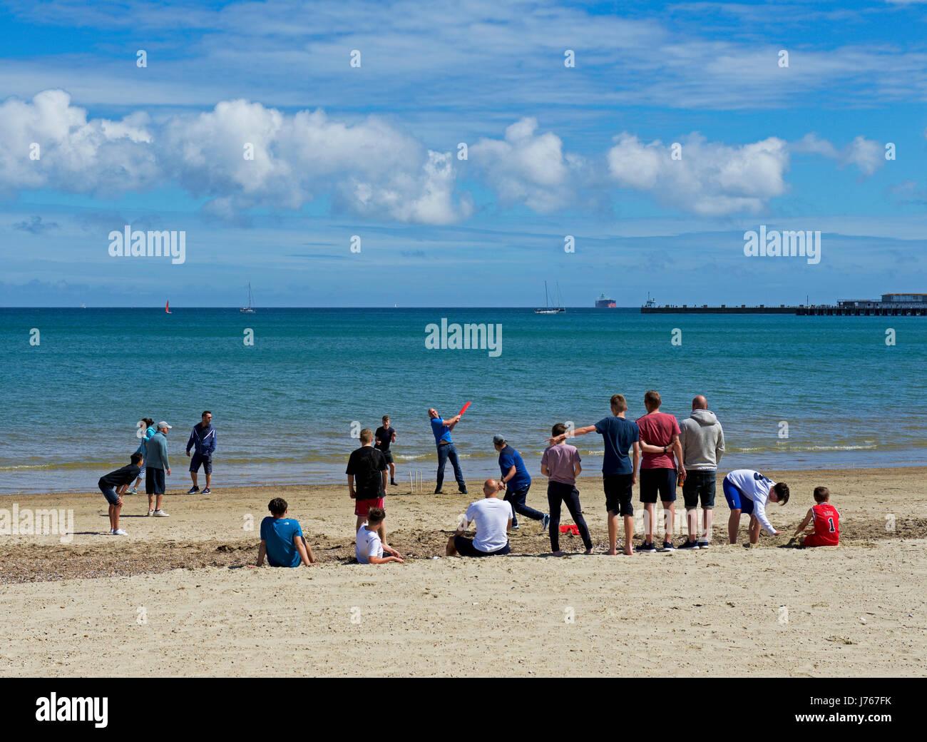 Cricket on the beach at Weymouth, Dorset, England UK - Stock Image