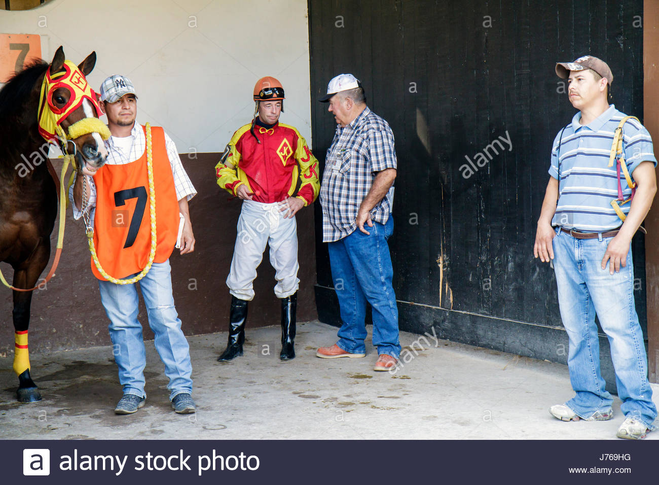 HialeahMiami Florida Hialeah Park quarter horse racing racetrack groom Hispanic man trainer stall jockey getting Stock Photo