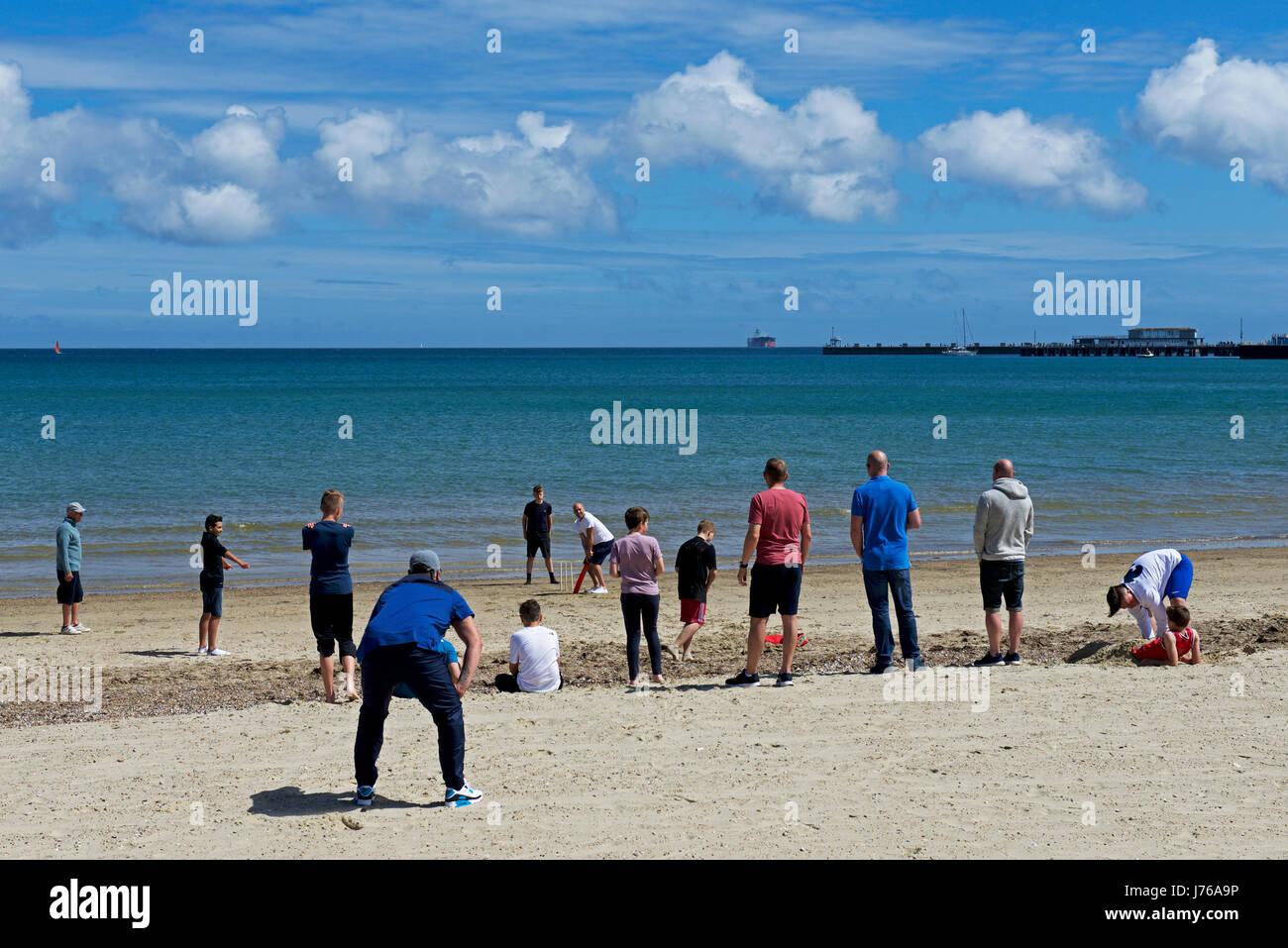 Cricket on the beach, Weymouth, Dorset, England UK - Stock Image