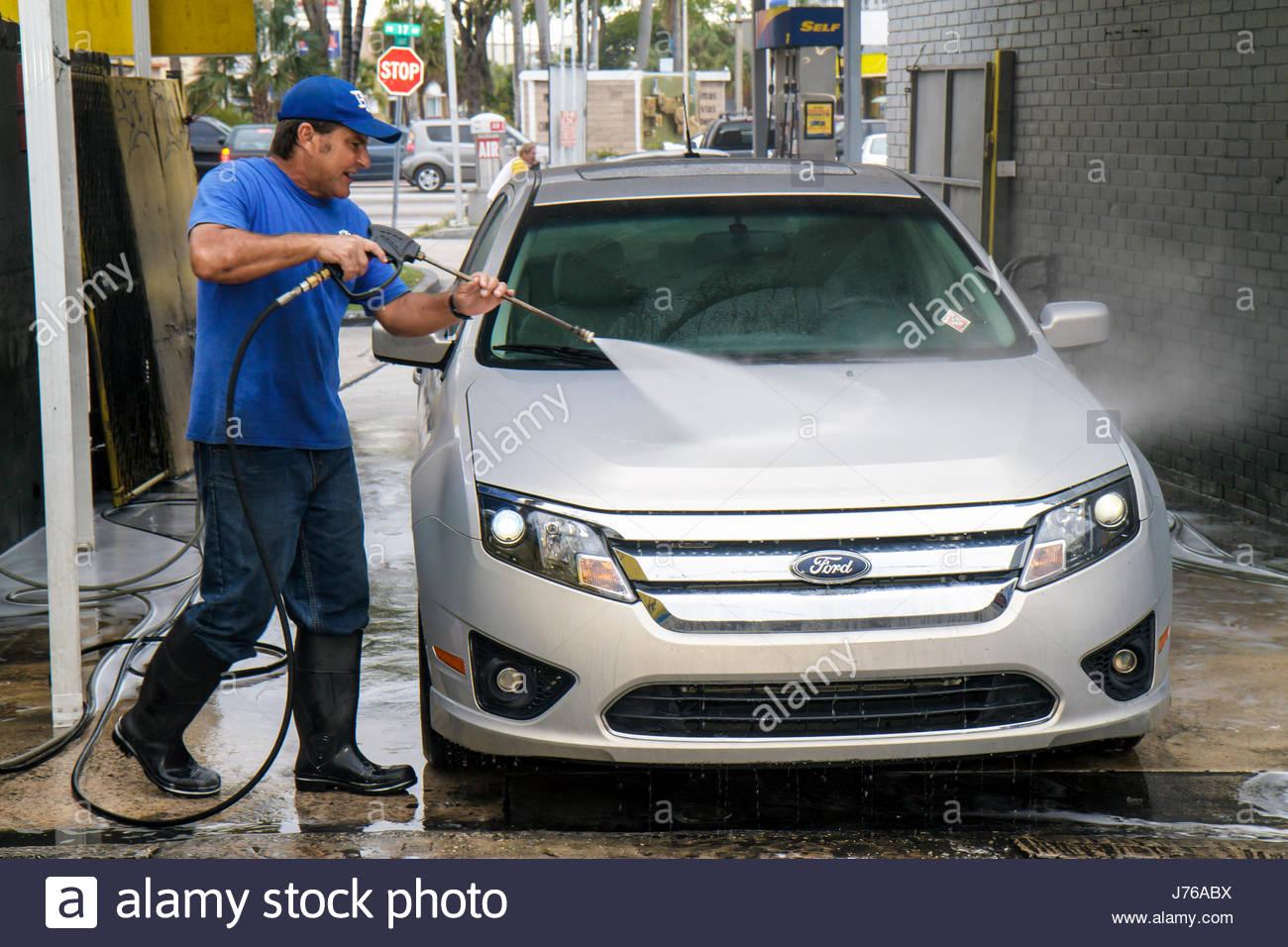 Spray Car Wash >> Miami Florida Car Wash Hispanic Man Jet Spray Gun Water