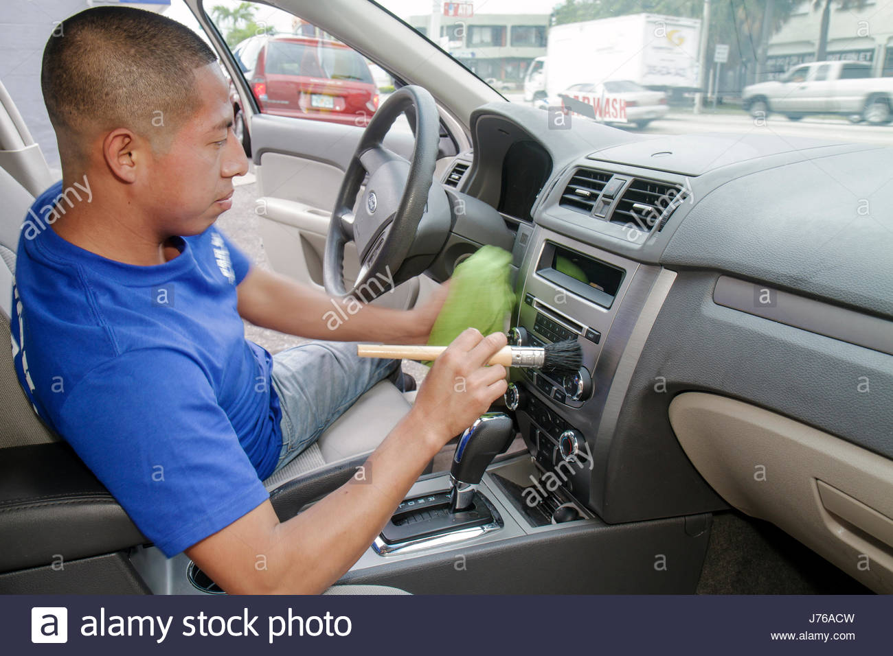 Miami Florida Car Wash Hispanic Man Cleaning Car Automobile Vehicle Work  Working Job Interior Dashboard