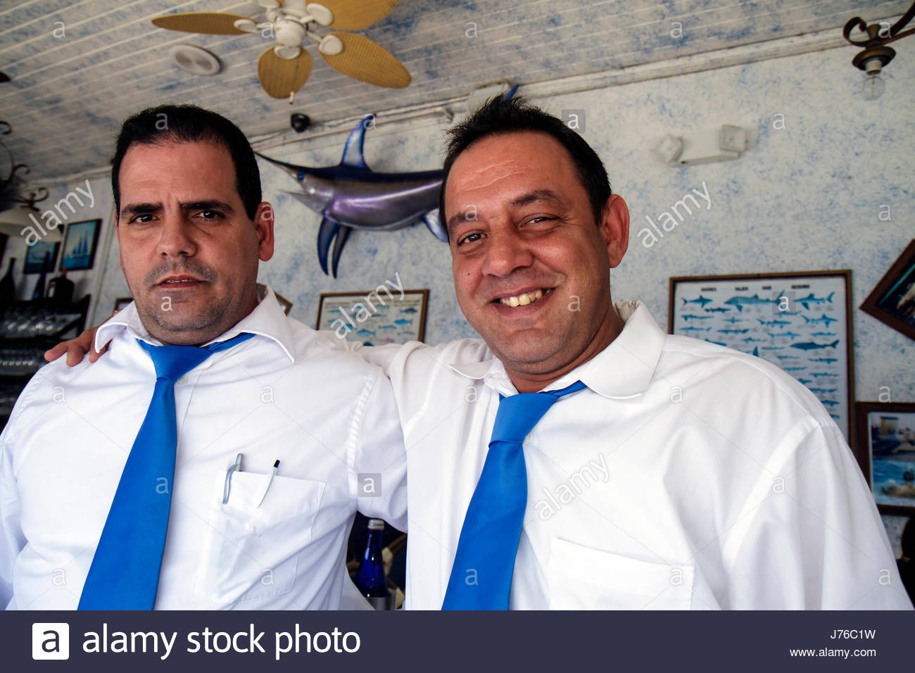 Miami Florida Casablanca Seafood Bar and & Grill restaurant Hispanic man men waiter co-workers job - Stock Image