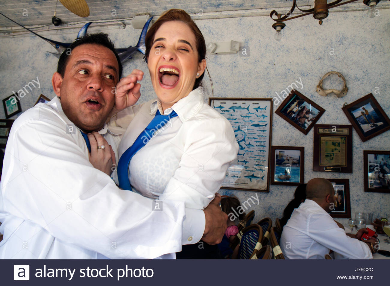 Miami Florida Casablanca Seafood Bar and & Grill restaurant Hispanic man woman waiter waitress co-workers horseplay - Stock Image